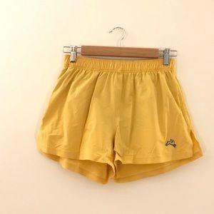 Tracksmith women's rare OG Waban running shorts XS yellow